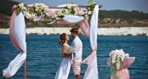https://www.freepik.com/premium-photo/bride-groom-white-clothes-with-bouquet-white-flowers-stand-arch-flowers-fabric-against-background-blue-lake-white-sand_9929327.htm