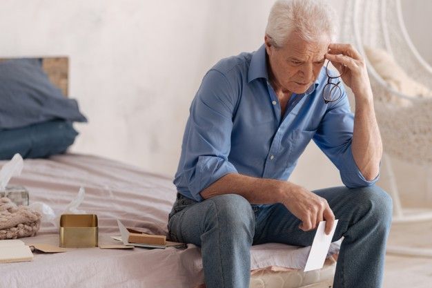 https://www.freepik.com/premium-photo/thoughtful-depressed-unhappy-man-holding-letter-touching-his-head-while-being-involved-his-memories_12735622.htm#page=3&query=widow&position=19