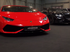 https://www.storyblocks.com/video/stock/front-view-of-a-red-lamborghini-at-a-car-exhibition-with-black-car-next-to-it-people-walk-in-the-background-sx-xiup1ik4sccsq6