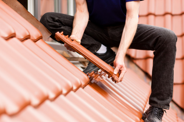 https://www.freepik.com/premium-photo/tiler-covering-roof-with-new-tile_3962284.htm#page=1&query=roofing&position=42