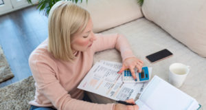 https://www.freepik.com/premium-photo/beautiful-young-albino-woman-sitting-with-calculator-bills-doing-paperwork-hand-woman-doing-finances-calculate-desk-about-cost-home-office-concept-work-from-home_8260784.htm#page=1&query=millennial%20debt&position=5
