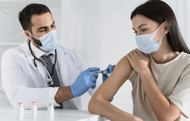 https://www.freepik.com/premium-photo/young-woman-being-vaccinated-by-doctor_11156679.htm