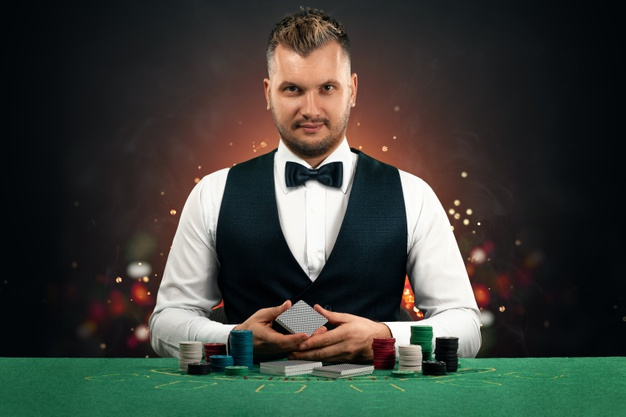 https://www.freepik.com/premium-photo/croupier-man-sits-table-with-chips-playing-cards_11478089.htm
