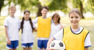 https://www.freepik.com/premium-photo/little-girl-holding-football-her-team-mates_9514034.htm#page=5&query=kid+sports&position=29