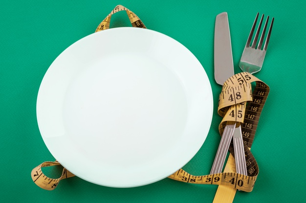 https://www.freepik.com/free-photo/empty-white-plate-with-measuring-tape-weight-loss-concept_10450704.htm
