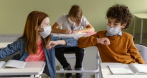 https://www.freepik.com/free-photo/front-view-children-with-medical-masks-doing-elbow-salute-class_12367048.htm