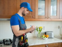 https://www.freepik.com/premium-photo/repairman-stands-kitchen-blue-cap-writes-tablet_13486791.htm#query=home%20warranty&position=19