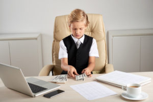 https://www.freepik.com/free-photo/young-caucasian-boy-sitting-executive-chair-office-counting-dollars-desk_5839208.htm#page=2&query=child+money&position=1