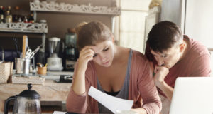 https://www.freepik.com/free-photo/young-married-couple-facing-financial-problem-during-economic-crisis-frustrated-woman-unhappy-man-studying-utility-bill-kitchen-shocked-with-amount-be-paid-gas-electricity_9532755.htm#page=1&query=family%20economics&position=25