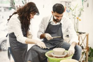 https://www.freepik.com/free-photo/mutual-creative-work-elegant-couple-casual-clothes-aprons-people-creating-bowl-pottery-wheel-clay-studio_13319762.htm#query=couple%20craft&position=39