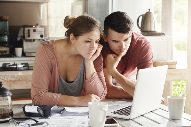 https://www.freepik.com/free-photo/young-man-woman-working-together-laptop-paying-utility-bills-via-internet-using-online-mortgage-calculator-save-money-home-loan-looking-screen-with-serious-concentrated-expression_9532761.htm