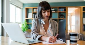 https://www.freepik.com/free-photo/portrait-young-woman-working-from-home-with-laptop-files-home-office-concept-new-normal-lifestyle_13414832.htm