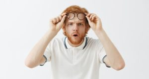 https://www.freepik.com/free-photo/confused-bearded-redhead-guy-posing-against-white-wall-with-glasses_11104179.htm#page=1&query=squinting&position=33