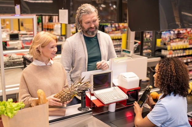 https://www.freepik.com/premium-photo/mature-couple-standing-by-cashier-counter-supermarket-while-young-woman-scanning-food-products-they-bought_11344332.htm?query=supermarket%20paying