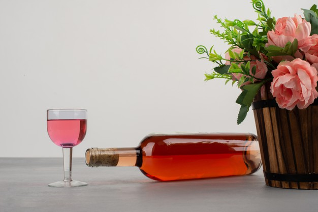 https://www.freepik.com/free-photo/beautiful-bouquet-flowers-bottle-rose-wine-grey-table_13030957.htm#page=2&query=Ros%C3%A9+wine&position=12