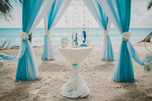 https://www.freepik.com/free-photo/blue-white-wedding-aisle-beach-surrounded-by-palms-with-sea-background_13499592.htm#page=1&query=beach+wedding&position=3