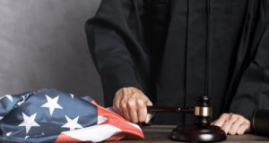 https://www.freepik.com/free-photo/close-up-judge-with-flag-striking-gavel_5236737.htm#page=1&query=judge&position=0