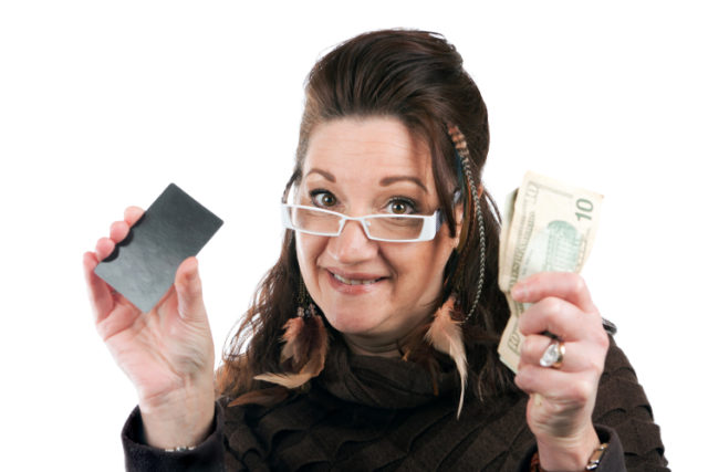 https://www.storyblocks.com/images/stock/brunette-woman-holding-up-a-blank-credit-card-business-card-shoppers-club-card-or-gift-card-of-some-sort-along-with-some-cash-in-her-other-hand-stqgbpcroiskjq8v2