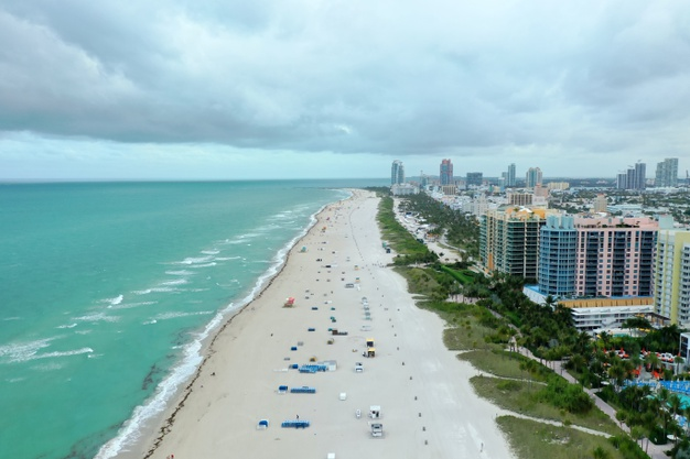 https://www.freepik.com/free-photo/miami-beach-with-buildings-right_10860186.htm#page=1&query=Beach%20buildings&position=23