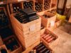 https://www.freepik.com/premium-photo/wine-cellar-with-glass-bottles-alcoholic-drink-wooden-boxes-wine-racks-with-vintage-year-labels_15724859.htm?query=wine%20store