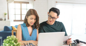 https://www.freepik.com/free-photo/serious-asian-husband-checking-analyzing-statement-utilities-bills-sitting-together-home_14057571.htm#page=1&query=couple%20finances&position=2
