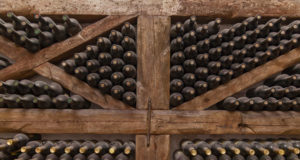 https://www.freepik.com/premium-photo/winy-bottles-lie-shelving-from-thick-logs-old-wine-cellars-with-bottles-barrels_17075633.htm?query=wine%20store