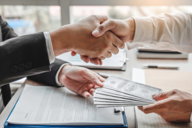 https://www.freepik.com/premium-photo/businessman-shaking-hands-giving-dollar-bills-corruption-bribery-business-manager-deal-contract_5288119.htm#page=1&query=money%20loan&position=25