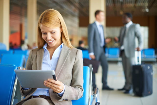 https://www.storyblocks.com/images/stock/happy-businesswoman-using-touchpad-with-her-partners-interacting-on-background-at-the-airport-bm3xu98dx_bj6gt2ulv