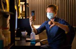 https://www.freepik.com/premium-photo/young-businessman-with-mask-giving-thumbs-down-video-calling-while-working-from-home-late-night_10273170.htm#page=1&query=covid%20phone%20thumbs%20down&position=2