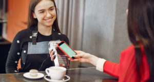 https://www.freepik.com/free-photo/girl-paying-her-latte-with-smartphone-by-contactless-pay-pass-technology_9246460.htm#page=1&query=contactless%20payment&position=1&from_view=search
